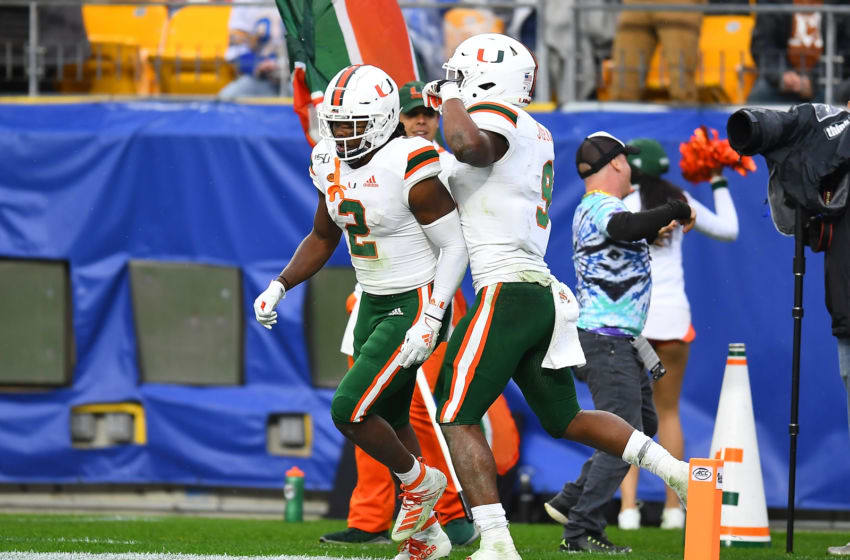PITTSBURGH, PA - OCTOBER 26: K.J. Osborn #2 celebrates his touchdown with Brevin Jordan #9 of the Miami Hurricanes during the fourth quarter against the Pittsburgh Panthers at Heinz Field on October 26, 2019 in Pittsburgh, Pennsylvania. Miami won the game 16-12. (Photo by Joe Sargent/Getty Images)
