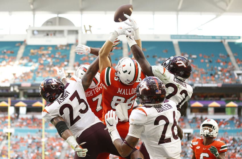 MIAMI, FLORIDA - OCTOBER 05: Will Mallory #85 of the Miami Hurricanes tips a pass that would be caught by Mark Pope #6 for a touchdown against the Virginia Tech Hokies during the first half at Hard Rock Stadium on October 05, 2019 in Miami, Florida. (Photo by Michael Reaves/Getty Images)