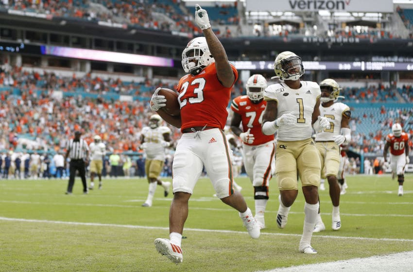 MIAMI, FLORIDA - OCTOBER 19: Cam'Ron Harris #23 of the Miami Hurricanes celebrates after scoring a touchdown against the Georgia Tech Yellow Jackets during the first half at Hard Rock Stadium on October 19, 2019 in Miami, Florida. (Photo by Michael Reaves/Getty Images)