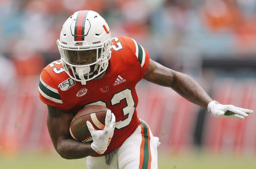 MIAMI, FLORIDA - OCTOBER 19: Cam'Ron Harris #23 of the Miami Hurricanes runs with the ball against the Georgia Tech Yellow Jackets during the first half at Hard Rock Stadium on October 19, 2019 in Miami, Florida. (Photo by Michael Reaves/Getty Images)