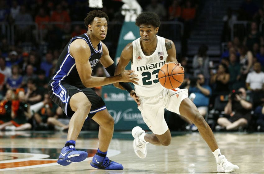 MIAMI, FLORIDA - JANUARY 04: Kameron McGusty #23 of the Miami Hurricanes drives past Wendell Moore Jr. #0 of the Duke Blue Devils during the second half at the Watsco Center on January 04, 2020 in Miami, Florida. (Photo by Michael Reaves/Getty Images)