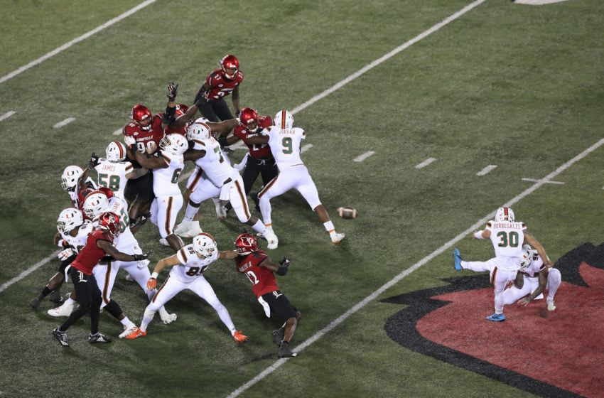 LOUISVILLE, KENTUCKY - SEPTEMBER 19: Jose Borregales #30 of the Miami Hurricanes kicks a field goal against the Louisville Cardinals at Cardinal Stadium on September 19, 2020 in Louisville, Kentucky. (Photo by Andy Lyons/Getty Images)