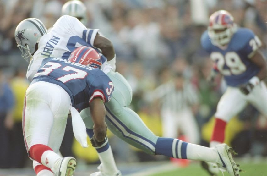 31 Jan 1993: Wide receiver Michael Irvin of the Dallas Cowboys is about to score his second touchdown while defense lineman Nate Odomes #37 of the Buffalo Bills charges against him during the second quarter of the Super Bowl XXVII game at the Rose Bowl i