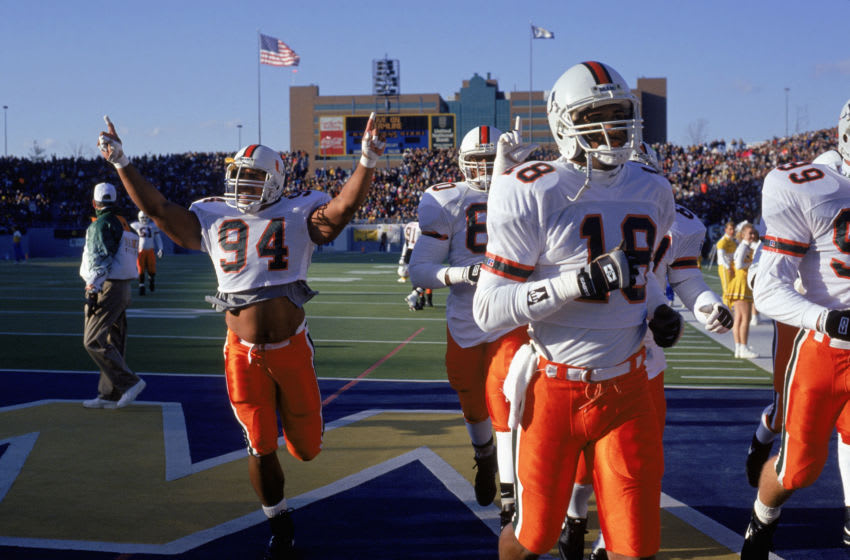NOVEMBER 20: Defensive end Dwayne Johnson #94 of the University of Miami Hurricanes raises his arms as he and his teammates leave the field during the NCAA game against West Virginia University on November 20, 1993. Dwayne Johnson is also known as