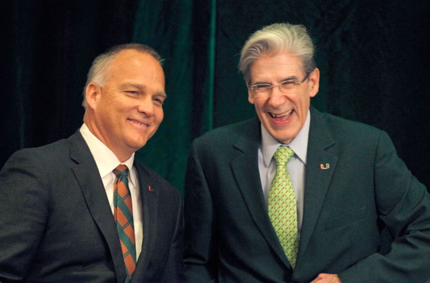 CORAL GABLES, FL - DECEMBER 04: New University of Miami Hurricanes head football coach Mark Richt, left, shares a light moment with University President Dr. Julio Frenk before Richt was introduced at a press conference at the school on December 4, 2015 in Coral Gables, Florida. (Photo by Joe Skipper/Getty Images)