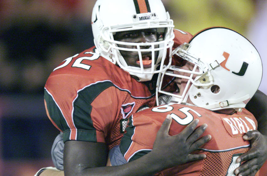 25 Oct 2001: Frank Gore #32 and Martin Bibla #65 of Miami celebrate during the game against West Virginia at the Orange Bowl in Miami, Florida. The University Of Miami won 45-3. DIGITAL IMAGE. Mandatory Credit: Eliot Schechter/Allsport
