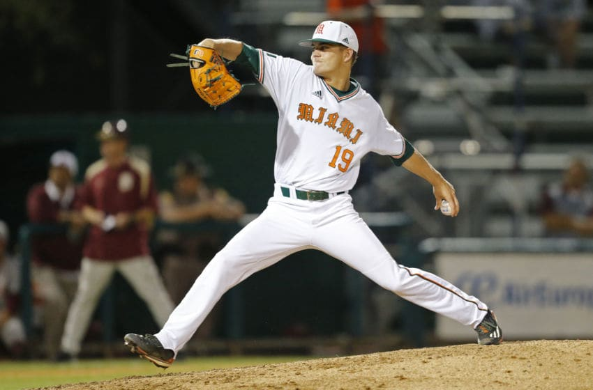 CORAL GABLES, FL - April 21: Jeb Bargfeldt #19 of the Miami Hurricanes throws the ball against the Florida State Seminoles during fourth inning action on April 21, 2017 at Alex Rodriguez Park at Mark Light Field in Coral Gables, Florida. The Seminoles defeated the Hurricanes 6-3. (Photo by Joel Auerbach/Getty Images)