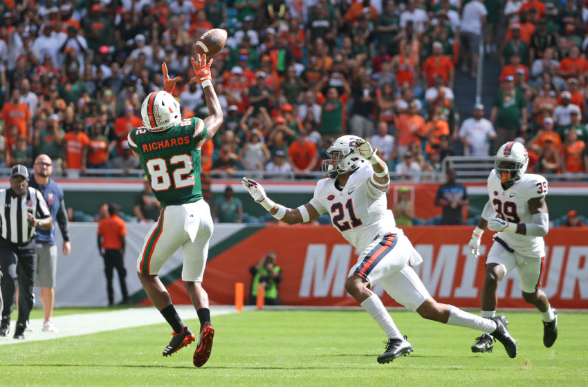 MIAMI GARDENS, FL - NOVEMBER 18: Ahmmon Richards #82 of the Miami Hurricanes catches the ball in front of Juan Thornhill #21 of the Virginia Cavaliers on November 18, 2017 at Hard Rock Stadium in Miami Gardens, Florida. Miami defeated Virginia 44-28. (Photo by Joel Auerbach/Getty Images)