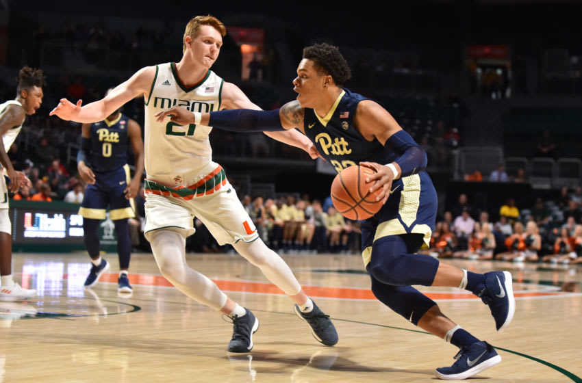 MIAMI, FL - JANUARY 31: Shamiel Stevenson #23 of the Pittsburgh Panthers drives to the basket while being defended by Sam Waardenburg #21 of the Miami Hurricanes during the first half of the game at The Watsco Center on January 31, 2018 in Miami, Florida. (Photo by Eric Espada/Getty Images)