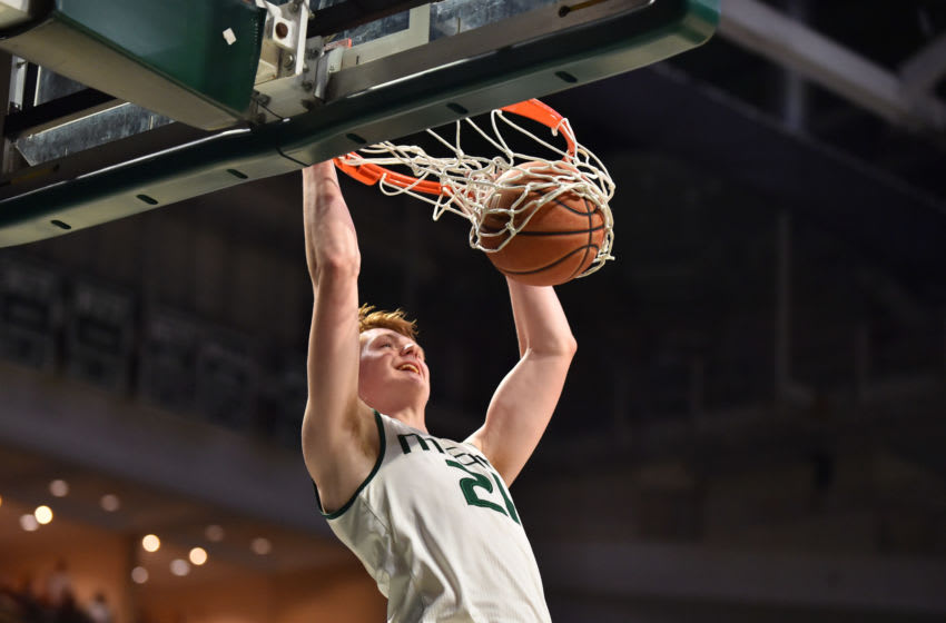 MIAMI, FL - JANUARY 31: Sam Waardenburg #21 of the Miami Hurricanes dunks the basketball during the second half of the game against the Pittsburgh Panthers at The Watsco Center on January 31, 2018 in Miami, Florida. (Photo by Eric Espada/Getty Images)