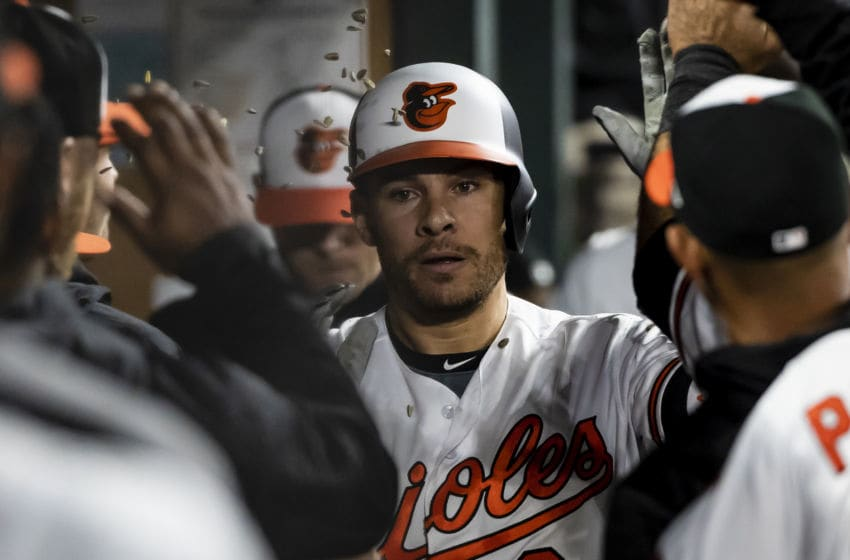 BALTIMORE, MD - APRIL 26: Danny Valencia #2 of the Baltimore Orioles celebrates in the dugout his solo home run during the eighth inning against the Tampa Bay Rays at Oriole Park at Camden Yards on April 26, 2018 in Baltimore, Maryland. (Photo by Scott Taetsch/Getty Images)