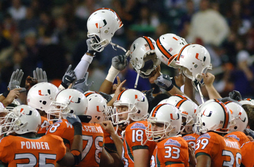 University of Miami players take the field before the 2005 Chick-fil-A Peach Bowl at the Georgia Dome in Atlanta, Georgia on December 30, 2005. LSU defeated Miami 40-3. (Photo by A. Messerschmidt/Getty Images) *** Local Caption ***