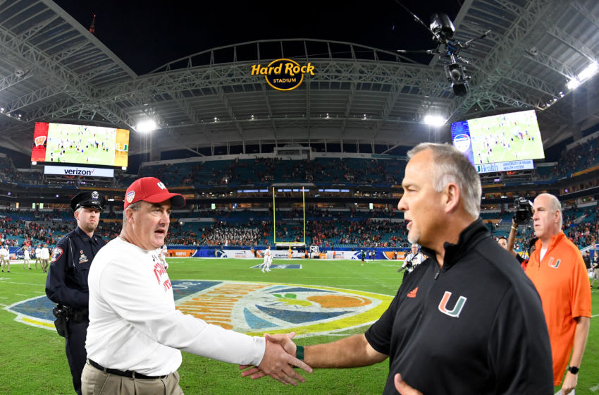 MIAMI GARDENS, FL - DECEMBER 30: Head coach Paul Chryst of the Wisconsin Badgers shakes hands with head coach Mark Richt of the Miami Hurricanes after the 2017 Capital One Orange Bowl at Hard Rock Stadium on December 30, 2017 in Miami Gardens, Florida. (Photo by Rob Foldy/Getty Images)