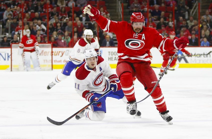 Apr 7, 2016; Raleigh, NC, USA; Carolina Hurricanes defensemen Justin Faulk (27) battles for the puck with Montreal Canadiens forward Brendan Gallagher (11) during the second period at PNC Arena. Mandatory Credit: James Guillory-USA TODAY Sports