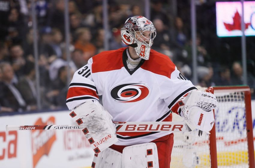 Feb 25, 2016; Toronto, Ontario, CAN; Carolina Hurricanes goaltender Cam Ward (30) during a break in the action against the Toronto Maple Leafs during the second period at the Air Canada Centre. Mandatory Credit: John E. Sokolowski-USA TODAY Sports