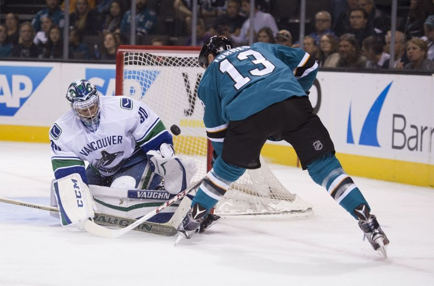 September 29, 2015; San Jose, CA, USA; Vancouver Canucks goalie Ryan Miller (30) makes a save against San Jose Sharks left wing Raffi Torres (13) during the second period at SAP Center at San Jose. Mandatory Credit: Kyle Terada-USA TODAY Sports