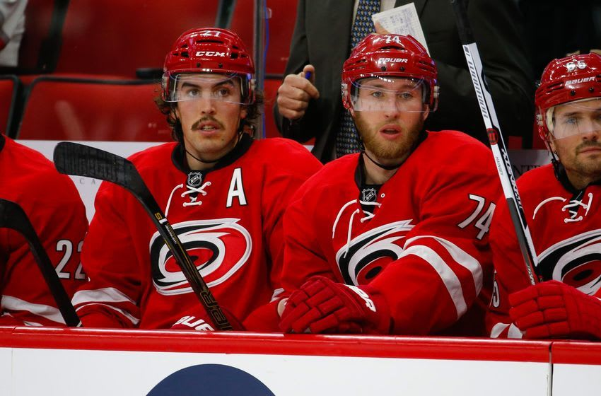 Nov 27, 2016; Raleigh, NC, USA; Carolina Hurricanes defensemen Justin Faulk (27) and defensemen Jaccob Slavin (74) looks on from the bench during the game against the Florida Panthers at PNC Arena. The Carolina Hurricanes defeated the Florida Panthers 3-2. Mandatory Credit: James Guillory-USA TODAY Sports