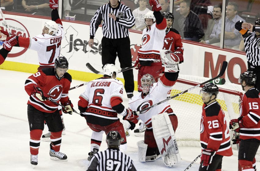 The Carolina Hurricanes' Joe Corvo (77), Eric Staal (12), Tim Gleason (6) and Cam Ward (30) celebrate as time runs out in Game 7 of an NHL playoffs series against the New Jersey Devils at the Prudential Center in Newark, New Jersey, Tuesday, April 28, 2009. The Hurricanes beat the Devils 4-3 to win the best-of-seven series, four games to three. (Photo by Chris Seward/Raleigh News & Observer/Tribune News Service via Getty Images)
