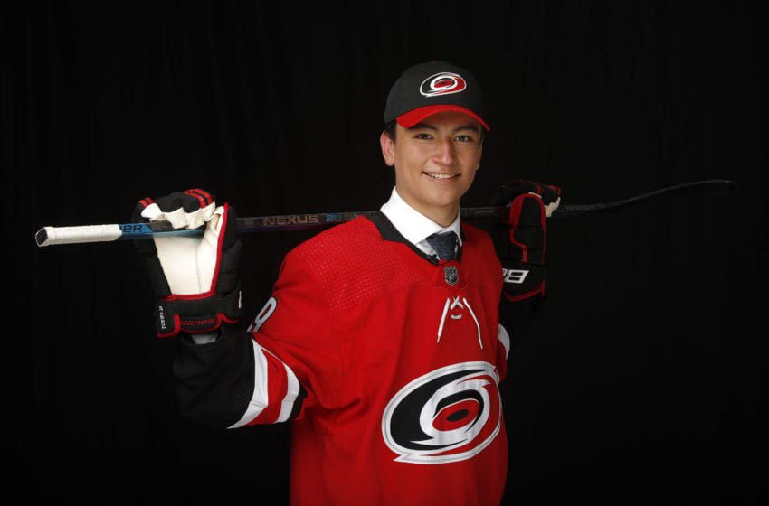 VANCOUVER, BRITISH COLUMBIA - JUNE 21: Ryan Suzuki poses for a portrait after being selected twenty-eighth overall by the Carolina Hurricanes during the first round of the 2019 NHL Draft at Rogers Arena on June 21, 2019 in Vancouver, Canada. (Photo by Kevin Light/Getty Images)
