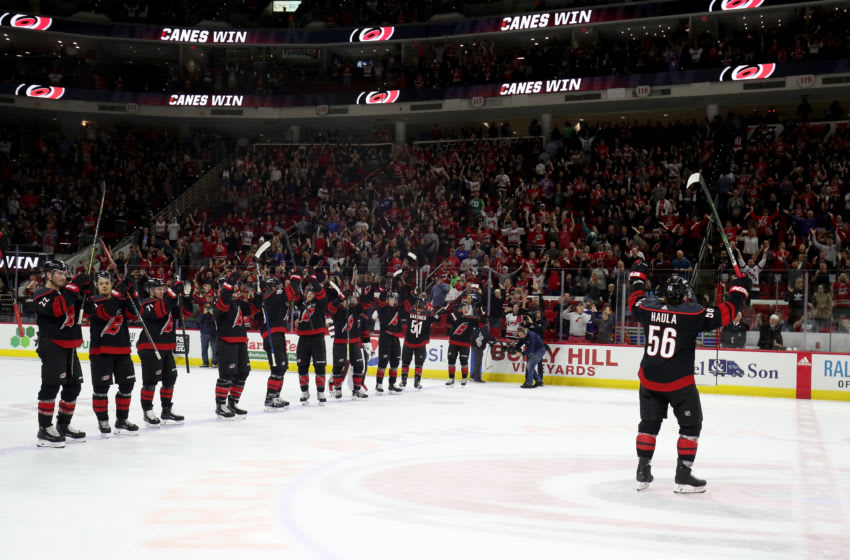RALEIGH, NC - OCTOBER 11: Erik Haula #56 of the Carolina Hurricanes leads teammates in a Storm Squad following a victory over the New York Islanders during an NHL game on October 11, 2019 at PNC Arena in Raleigh North Carolina. (Photo by Gregg Forwerck/NHLI via Getty Images)
