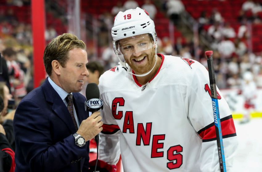 RALEIGH, NC - OCTOBER 12: Carolina Hurricanes Defenceman Dougie Hamilton (19) has fun in an interview with FOX Sports during warmups before a game between the Columbus Blue Jackets and the Carolina Hurricanes on October 12, 2019 at the PNC Arena in Raleigh, NC. (Photo by John McCreary/Icon Sportswire via Getty Images)
