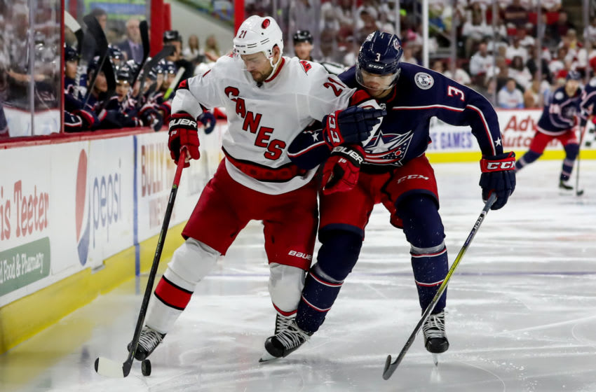 RALEIGH, NC - OCTOBER 12: Carolina Hurricanes Left Wing Nino Niederreiter (21) and Columbus Blue Jackets Defenceman Seth Jones (3) battle for positioning during a game between the Columbus Blue Jackets and the Carolina Hurricanes on October 12, 2019 at the PNC Arena in Raleigh, NC. (Photo by John McCreary/Icon Sportswire via Getty Images)