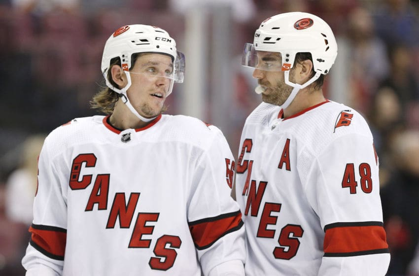 SUNRISE, FLORIDA - OCTOBER 08: Erik Haula #56 and Jordan Martinook #48 of the Carolina Hurricanes talk against the Florida Panthers during the third period at BB&T Center on October 08, 2019 in Sunrise, Florida. (Photo by Michael Reaves/Getty Images)