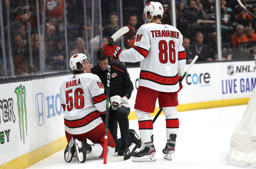 ANAHEIM, CALIFORNIA - OCTOBER 18: Teuvo Teravainen #86 looks on as Erik Haula #56 of the Carolina Hurricanes is slow to get up off the ice after a check by Josh Manson #42 of the Anaheim Ducks during the second period of a game at Honda Center on October 18, 2019 in Anaheim, California. (Photo by Sean M. Haffey/Getty Images)