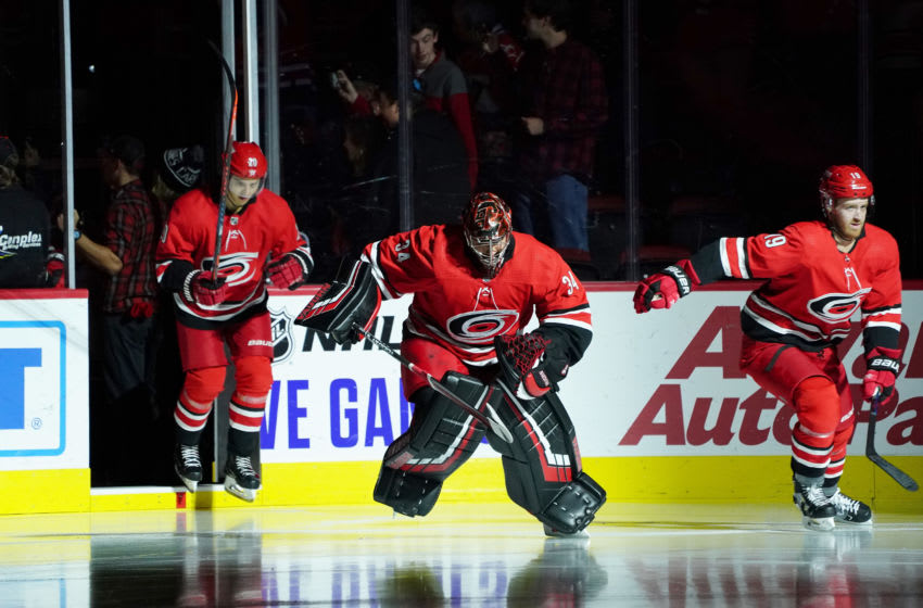 RALEIGH, NC - OCTOBER 29: Petr Mrazek #34 of the Carolina Hurricanes enters the ice during warmups with teammates Dougie Hamilton #19 and Sebastian Aho #20 prior to an NHL game against the Calgary Flames on October 29, 2019 at PNC Arena in Raleigh, North Carolina. (Photo by Gregg Forwerck/NHLI via Getty Images)