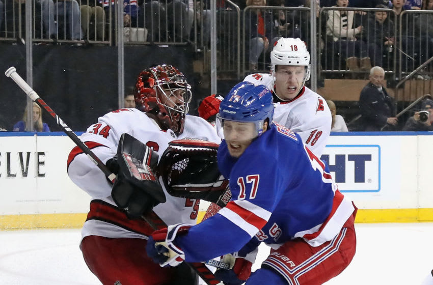 NEW YORK, NEW YORK - NOVEMBER 27: Jesper Fast #17 of the New York Rangers attempts to avoid contact with Petr Mrazek #34 of the Carolina Hurricanes during the second period at Madison Square Garden on November 27, 2019 in New York City. The Rangers defeated the Hurricanes 3-2. (Photo by Bruce Bennett/Getty Images)
