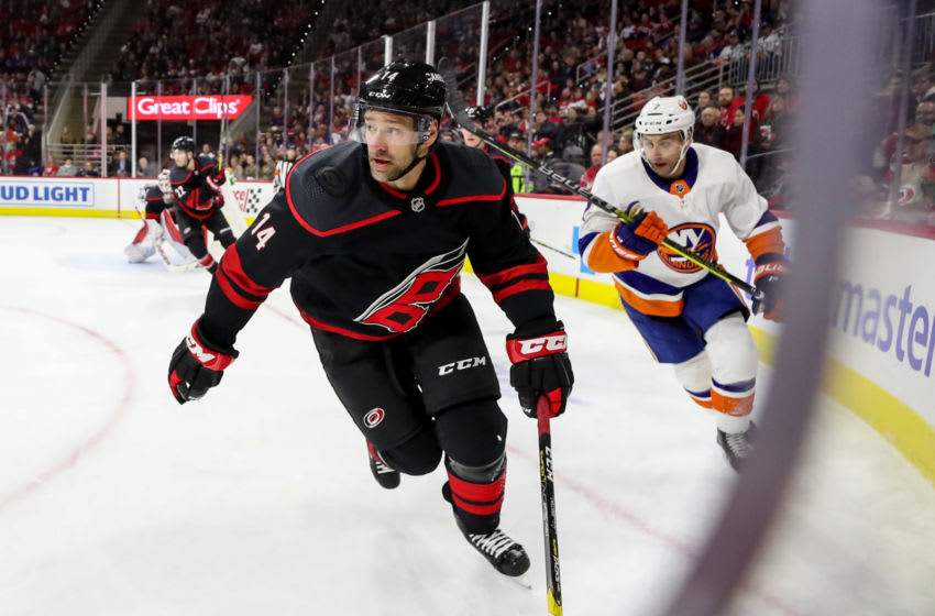 RALEIGH, NC - JANUARY 19: Carolina Hurricanes Right Wing Justin Williams (14) looks up ice during an NHL game between the Carolina Hurricanes and New York Islanders on January 19, 2020 at the PNC Arena in Raleigh, NC. (Photo by John McCreary/Icon Sportswire via Getty Images)