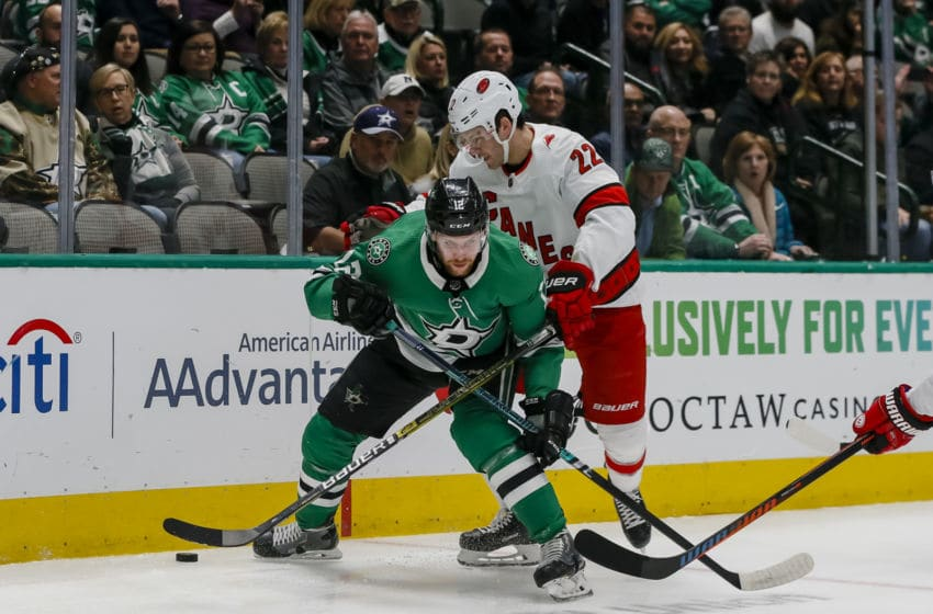 DALLAS, TX - FEBRUARY 11: Dallas Stars center Radek Faksa (12) and Carolina Hurricanes defenseman Brett Pesce (22) battle for the puck during the game between the Dallas Stars and the Carolina Hurricanes on February 11, 2019 at American Airlines Center in Dallas, Texas. (Photo by Matthew Pearce/Icon Sportswire via Getty Images)