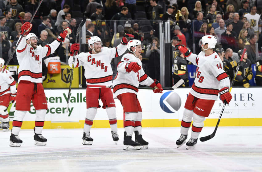 LAS VEGAS, NEVADA - FEBRUARY 08: The Carolina Hurricanes celebrate after defeating the Vegas Golden Knights in a shootout at T-Mobile Arena on February 08, 2020 in Las Vegas, Nevada. (Photo by Jeff Bottari/NHLI via Getty Images)