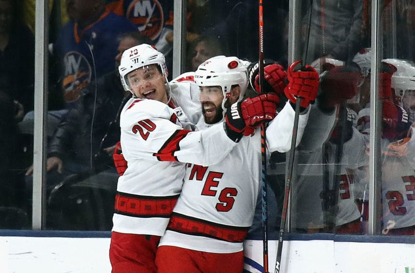UNIONDALE, NEW YORK - MARCH 07: Sebastian Aho #20 and Vincent Trocheck #16 of the Carolina Hurricanes celebrate their 3-2 overtime victory over the New York Islanders at NYCB Live's Nassau Coliseum on March 07, 2020 in Uniondale, New York. (Photo by Bruce Bennett/Getty Images)