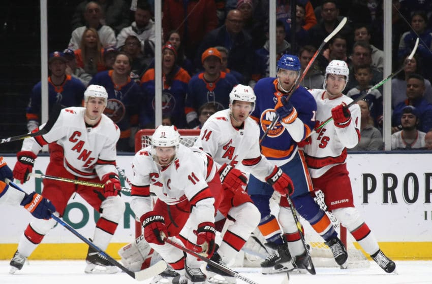 UNIONDALE, NEW YORK - MARCH 07: Jordan Staal #11 and the Carolina Hurricanes defend against the New York Islanders at NYCB Live's Nassau Coliseum on March 07, 2020 in Uniondale, New York. (Photo by Bruce Bennett/Getty Images)