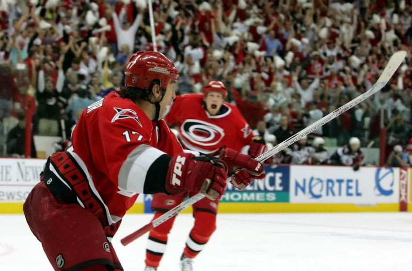 Rod Brind'Amour #17 of the Carolina Hurricanes celebrates his game-winning goal with teammate Eric Staal #12 (Photo by Jim McIsaac/Getty Images)