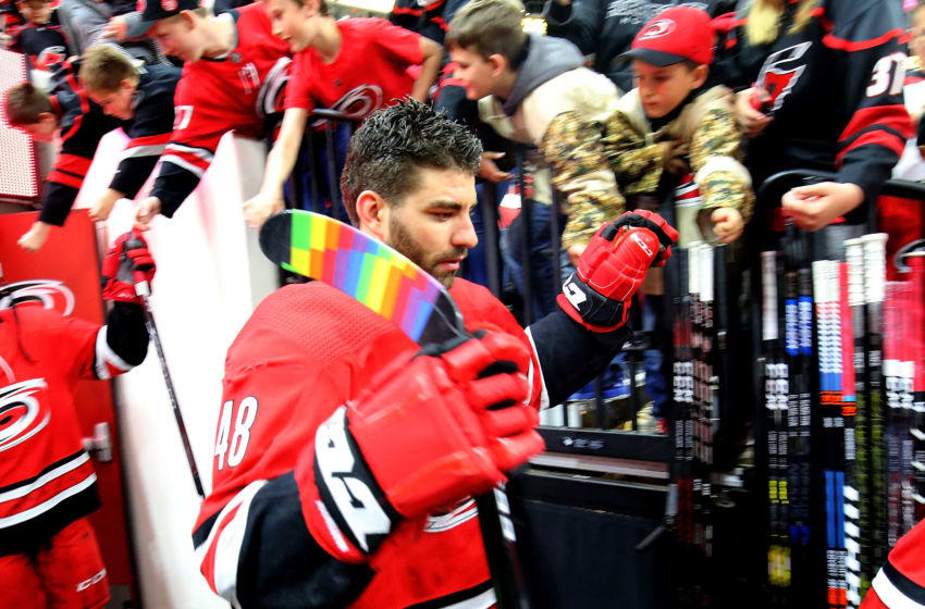 RALEIGH, NC - MARCH 24: Jordan Martinook #48 of the Carolina Hurricanes enters the ice with pride tape on his blade to honor Pride Night during the Hockey is for Everyone initiative prior to an NHL game on March 24, 2019 at PNC Arena in Raleigh, North Carolina. (Photo by Gregg Forwerck/NHLI via Getty Images)