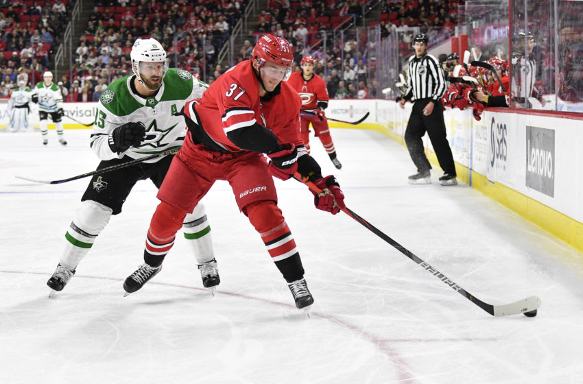 RALEIGH, NORTH CAROLINA - FEBRUARY 25: Blake Comeau #15 of the Dallas Stars defends Andrei Svechnikov #37 of the Carolina Hurricanes during the third period of their game at PNC Arena on February 25, 2020 in Raleigh, North Carolina. The Stars won 4-1. (Photo by Grant Halverson/Getty Images)
