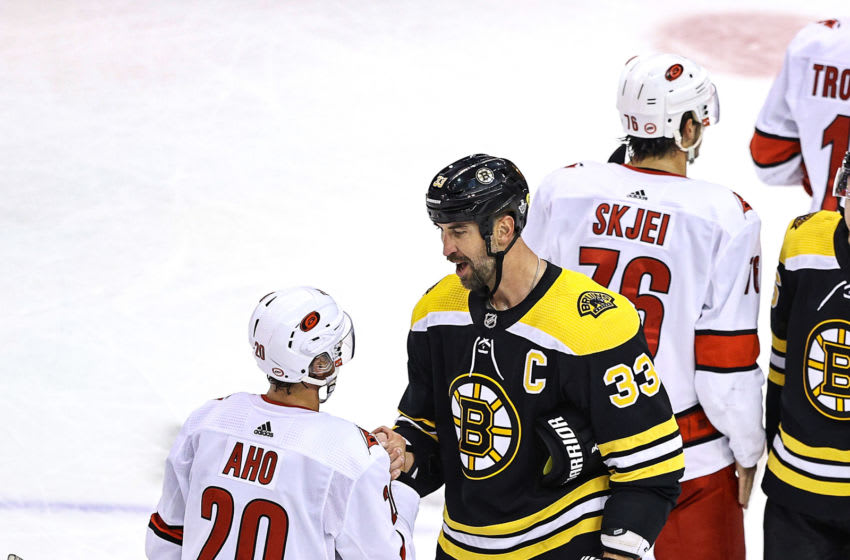 TORONTO, ONTARIO - AUGUST 19: Sebastian Aho #20 of the Carolina Hurricanes shakes hands with Zdeno Chara #33 of the Boston Bruins after the Bruins 2-1 win in Game Five of the Eastern Conference First Round during the 2020 NHL Stanley Cup Playoffs at Scotiabank Arena on August 19, 2020 in Toronto, Ontario. (Photo by Elsa/Getty Images)