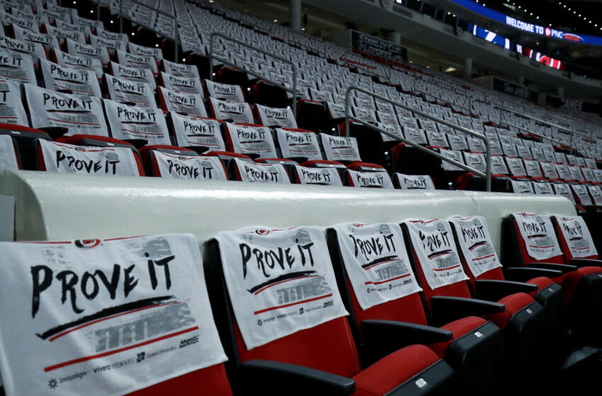RALEIGH, NORTH CAROLINA - MAY 30: Playoff towels are draped oj the seats before Game One of the Second Round of the 2021 Stanley Cup Playoffs between the Carolina Hurricanes and the Tampa Bay Lightning at PNC Arena on May 30, 2021 in Raleigh, North Carolina. (Photo by Grant Halverson/Getty Images)