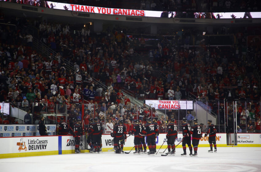 RALEIGH, NORTH CAROLINA - JUNE 08: The Carolina Hurricanes exit the ice following Game Five of the Second Round of the 2021 Stanley Cup Playoffs against the Tampa Bay Lightning at PNC Arena on June 08, 2021 in Raleigh, North Carolina. (Photo by Jared C. Tilton/Getty Images)