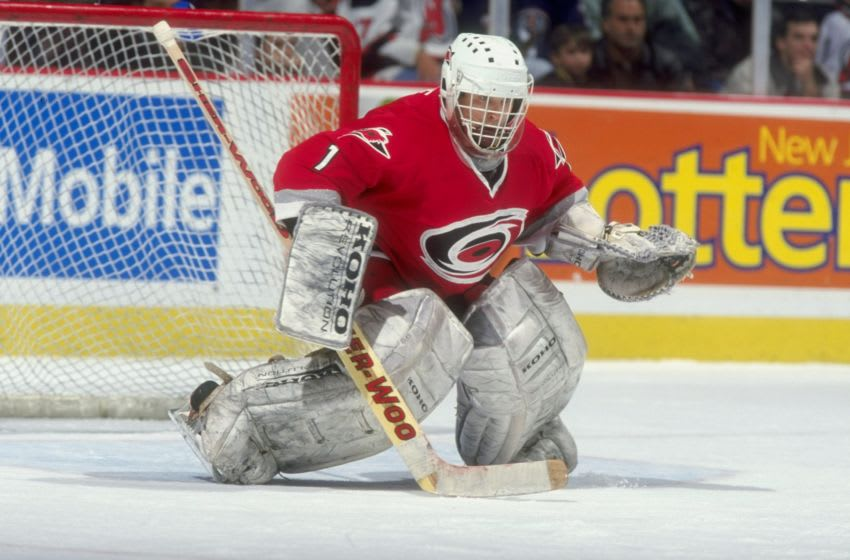 19 Nov 1998: Goalie Arturs Irbe #1 of the Carolina Hurricanes prepares to make a stop during a game against the New Jersey Devils at the Continental Airlines Arena in East Rutherford, New Jersey. The Devils defeated the Hurricanes 3-2. Mandatory Credit: Al Bello /Allsport