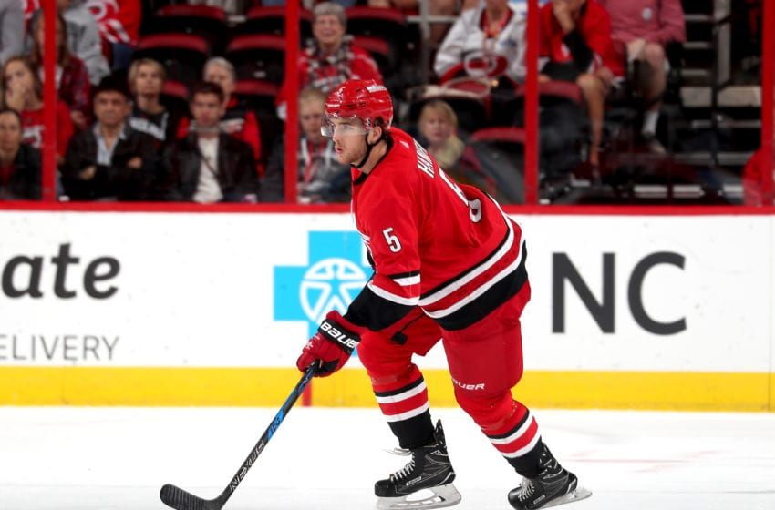 RALEIGH, NC - OCTOBER 10: Noah Hanifin #5 of the Carolina Hurricanes skates with the puck during an NHL game against the Columbus Blue Jackets on October 10, 2017 at PNC Arena in Raleigh, North Carolina. (Photo by Gregg Forwerck/NHLI via Getty Images)