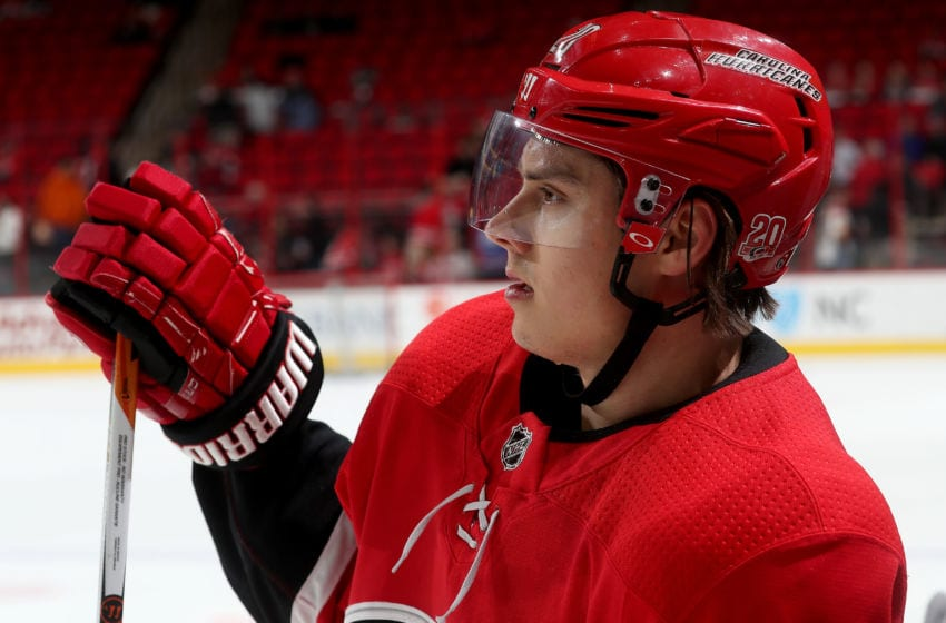 RALEIGH, NC - MARCH 20: Sebastian Aho #20 of the Carolina Hurricanes is photographed during warmups prior to an NHL game against the Edmonton Oilers on March 20, 2018 at PNC Arena in Raleigh, North Carolina. (Photo by Gregg Forwerck/NHLI via Getty Images)
