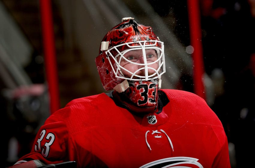 RALEIGH, NC - FEBRUARY 2: Scott Darling #33 of the Carolina Hurricanes takes a water break during a time out of and NHL game against the Detroit Red Wings on February 2, 2018 at PNC Arena in Raleigh, North Carolina. (Photo by Gregg Forwerck/NHLI via Getty Images)