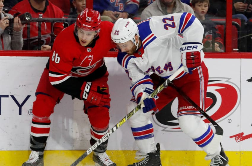 RALEIGH, NC - FEBRUARY 19: Teuvo Teravainen #86 of the Carolina Hurricanes battles Kevin Shattenkirk #22 of the New York Rangers during an NHL game on February 19, 2019 at PNC Arena in Raleigh, North Carolina. (Photo by Karl DeBlaker/NHLI via Getty Images)