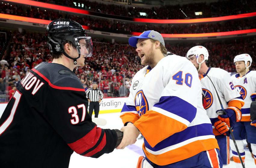 RALEIGH, NC - MAY 03: Andrei Svechnikov #37 of the Carolina Hurricanes shakes hands with Robin Lehner #40 of the New York Islanders following Game Four of the Eastern Conference Second Round during the 2019 NHL Stanley Cup Playoffs on May 3, 2019 at PNC Arena in Raleigh, North Carolina. (Photo by Gregg Forwerck/NHLI via Getty Images)