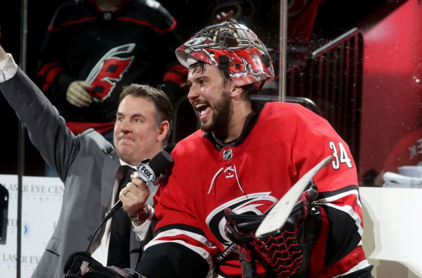 RALEIGH, NC - APRIL 4: Game night host Mike Maniscalco of the Carolina Hurricanes interviews Petr Mrazek #34 during an NHL game against the New Jersey Devils at PNC Arena on April 4, 2019, in Raleigh, North Carolina. (Photo by Gregg Forwerck/NHLI via Getty Images)