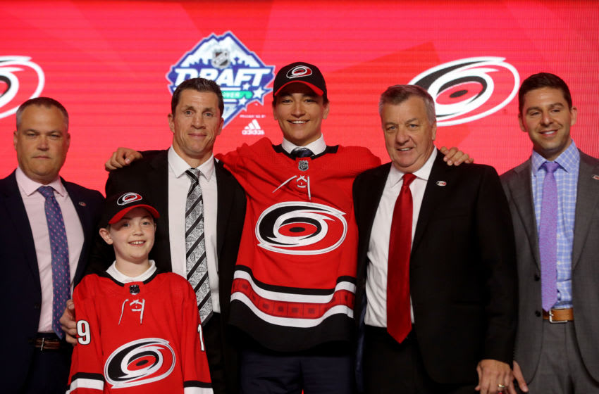 VANCOUVER, BRITISH COLUMBIA - JUNE 21: Ryan Suzuki reacts after being selected twenty-eighth overall by the Carolina Hurricanes during the first round of the 2019 NHL Draft at Rogers Arena on June 21, 2019 in Vancouver, Canada. (Photo by Bruce Bennett/Getty Images)