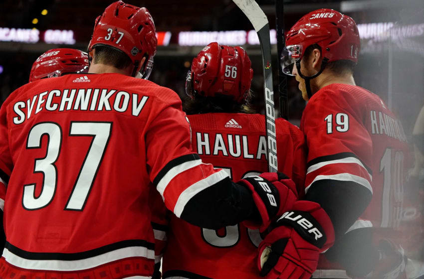 RALEIGH, NC - OCTOBER 6: Erik Haula #56 of the Carolina Hurricanes celebrates after scoring a goal with teammates Andrei Svechnikov #37 and Dougie Hamilton #19 during an NHL game against the Tampa Bay Lightning on October 6, 2019 at PNC Arena in Raleigh North Carolina. (Photo by Gregg Forwerck/NHLI via Getty Images)